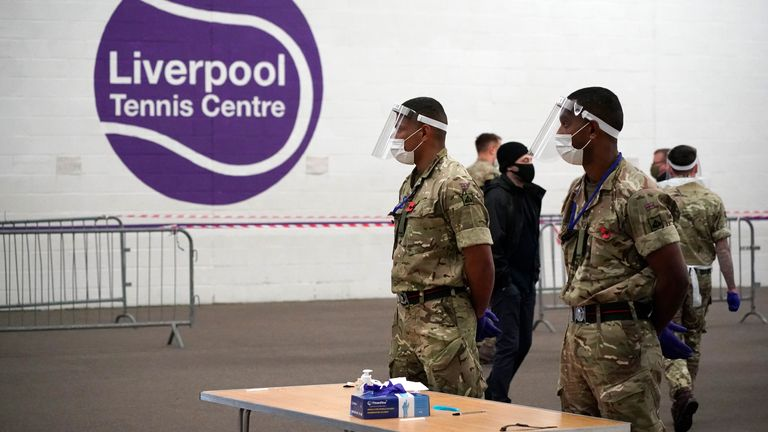 LIVERPOOL, ENGLAND - NOVEMBER 06: Soldiers from the Yorkshire Regiment prepare a mass Covid-19 testing site in the Liverpool Tennis centre at Wavertree Sports Park on November 6, 2020 in Liverpool, England. The government are piloting loop mediated isothermal amplification (LAMP) Coronavirus testing technology, offering all Liverpool residents quick-result tests to identify who has COVID-19 and asking them to isolate. If this technology is successful it could lead to an end to lockdowns as a met