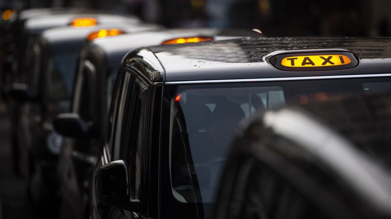 A queue of black cabs outside Victoria Station, London. London taxi drivers are facing long waits for a single fare after the industry has seen a severe drop in demand as coronavirus restrictions continue to reduce travel and office working.