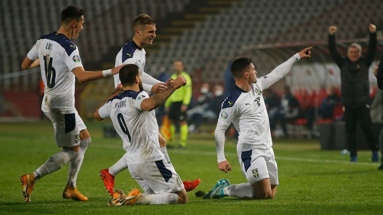 Luka Jovic of Serbia celebrates after scoring his team's first goal during the UEFA EURO 2020 Play-Off Final between Serbia and Scotland at Rajko Mitic Stadium on November 12, 2020 in Belgrade, Serbia