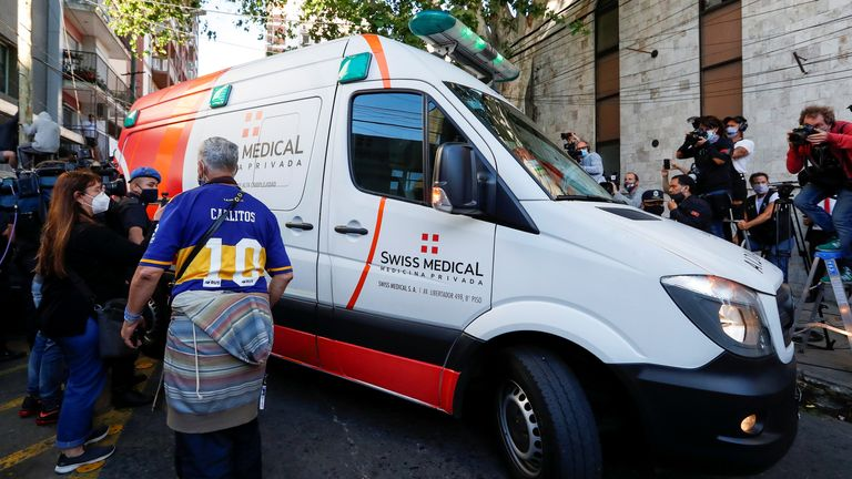 An ambulance carrying Diego Maradona leaves the Buenos Aires clinic where he had brain surgery