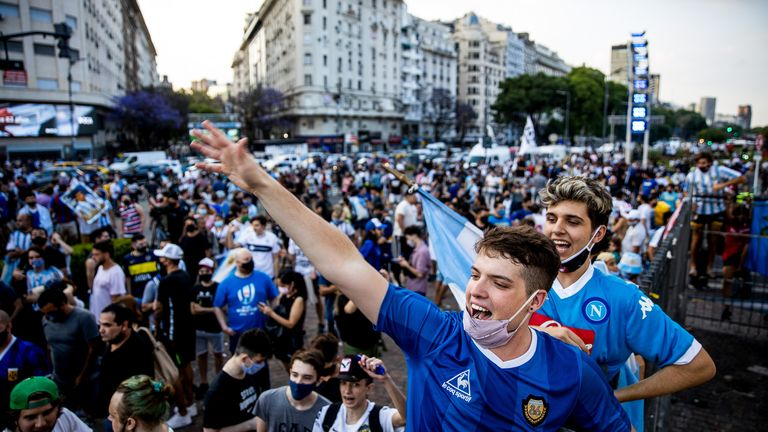 Fans cheer for Diego Maradona after the news of his death on November 26, 2020 in Buenos Aires, Argentina
