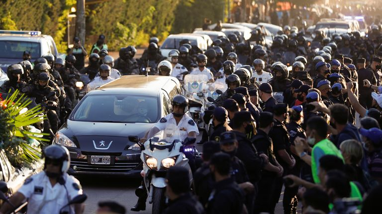The hearse carrying the casket of footbll legend Diego Maradona arrives at the cemetery in Buenos Aires, Argentina