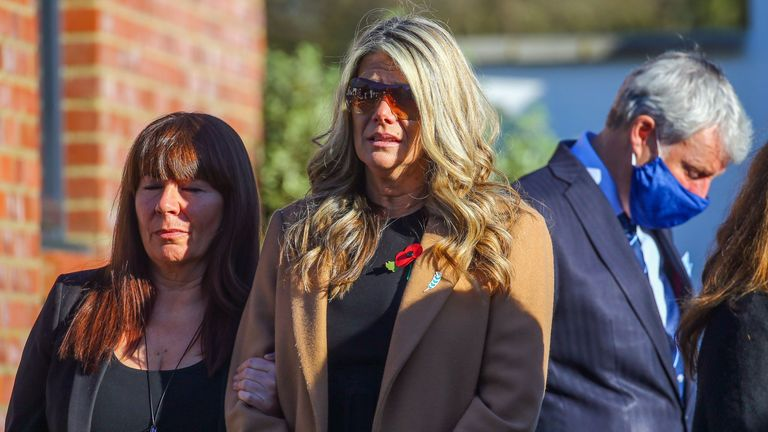 Su Bushby (centre), watches as the hearse departs, following the funeral service of her partner, police officer Sergeant Matt Ratana, in Shoreham-by-Sea, West Sussex.