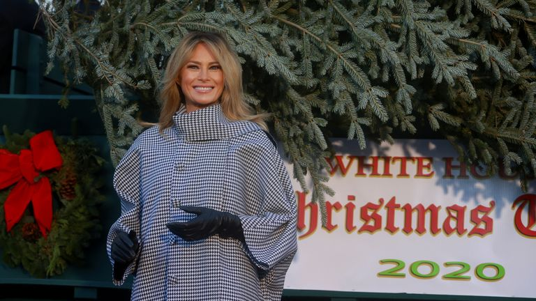 U.S. first lady Melania Trump welcomes the arrival of the White House Christmas Tree, an 18.5-foot Fraser Fir from Oregon, outside the White House in Washington, U.S., November 23, 2020. REUTERS/Hannah McKay
