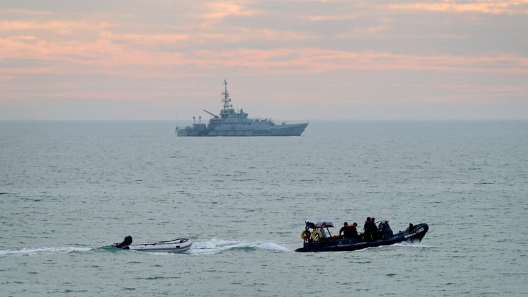 11:29 - 9 Nov 2020 POLITICS Migrants Download Migrant Channel crossing incidents A small boat is towed by a Border Force vessel as Border Force Searcher (top) patrols the coastline following a small boat incident in the Channel earlier this morning.