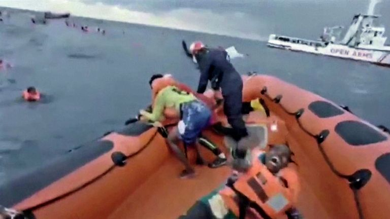 """I lost my baby, where's my baby?"" screamed a desperate mother after being pulled from the water by rescuers as packed dinghy sank"