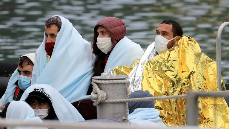 People thought to be migrants are pictured on a Border Force boat in Dover on Friday