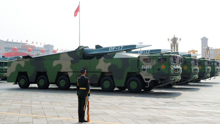 Military vehicles carrying hypersonic missiles DF-17 drive past Tiananmen Square