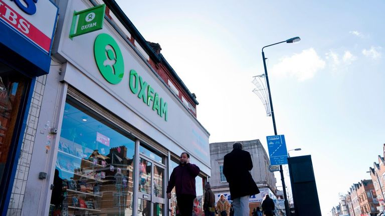 People walk past a high street branch of an Oxfam charity shop in south London on February 17, 2018. Oxfam fired four staff members for gross misconduct and allowed three others to resign following an internal inquiry into what happened in Haiti in 2011. / AFP PHOTO / Justin TALLIS (Photo credit should read JUSTIN TALLIS/AFP via Getty Images)
