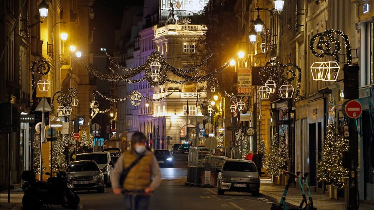Rue Saint-Honore in Paris is decorated with illuminations for Christmas