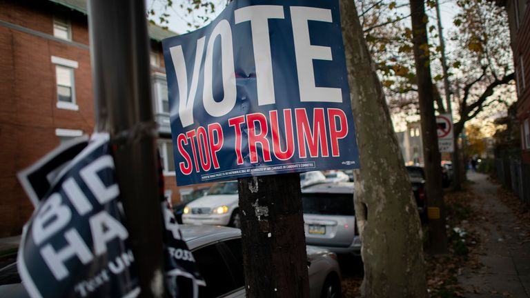 "A sign posted to a telephone pole reads ""VOTE STOP TRUMP,"" as general election ballots are still being tabulated in the city, seven days after country went to the polls, on November 10, 2020 in Philadelphia, Pennsylvania."