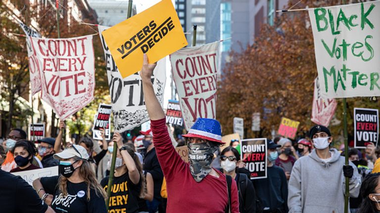 Crowds in Philadelphia carry 'voters decide' and 'count every vote' placards