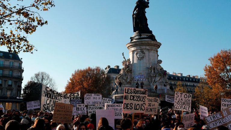 Demonstrators hold signs reading 'Ministry of shame' and 'Powerful people above the laws' on the Place de la Republique