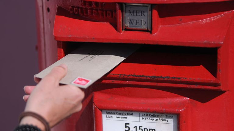 PENARTH, WALES - APRIL 15: A letter is posted into a red postbox on April 15, 2020 in Penarth, Wales. The Coronavirus (COVID-19) pandemic has spread to many countries across the world, claiming over 120,000 lives and infecting over 2 million people. (Photo by Stu Forster/Getty Images)