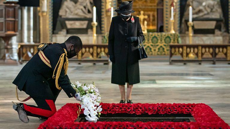 The Queen's Equerry, Lieutenant Colonel Nana Kofi Twumasi-Ankrah, placed a bouquet on the grave
