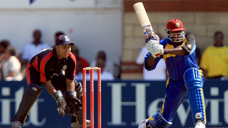 PCA Masters' Ismail Dawood (l) keeps wicket as Barbados XI's Courtney Brown hits away