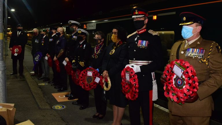 Members of the armed forces stood at Penzance station in Cornwall before the wreaths were taken on a train to London for 11am