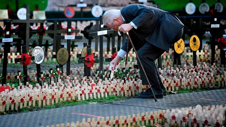 A man places a cross in the Field of Remembrance at Westminster Abbey earlier this week