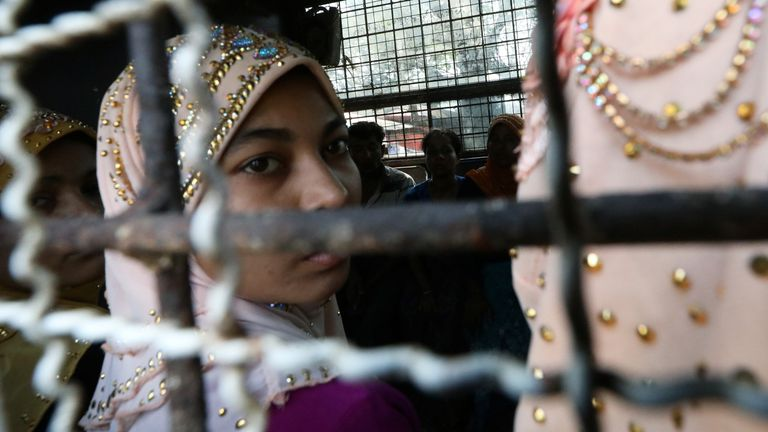 Arrested Rohingya people arrive at a Hlegu court to face charges of traveling illegally, outside Yangon, Myanmar, February 21, 2020. REUTERS/Ann Wang