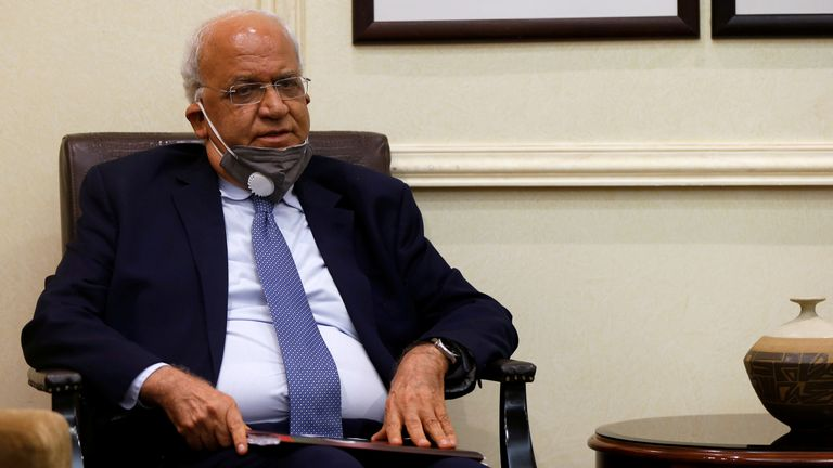 Saeb Erekat is pictured wearing mask at a meeting with ministers in Jordan in September