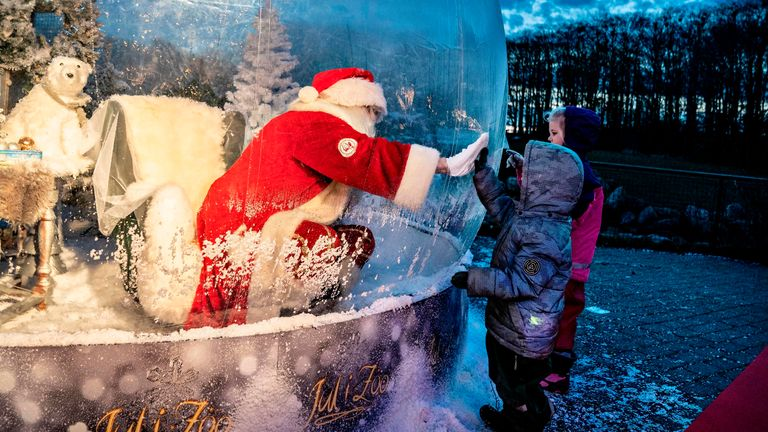 A Santa is seen in a coronavirus-safe plastic bubble at the Zoo in Aalborg, Denmark