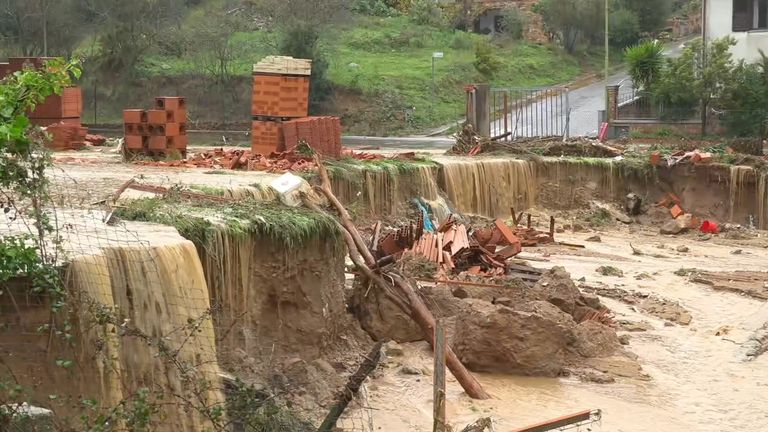 Still image taken from video shows a collapsed road from flash flooding in the town of Bitti, Italy November 28, 2020. Local Team/Reuters TV via REUTERS ATTENTION EDITORS - ITALY OUT. NO COMMERCIAL OR EDITORIAL SALES IN ITALY AND .IT WEBSITES. THIS IMAGE HAS BEEN SUPPLIED BY A THIRD PARTY