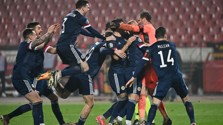 Scotland's players celebrate after winning the Euro 2020 play-off qualification football match between Serbia and Scotland at the Red Star Stadium in Belgrade on November 12, 2020