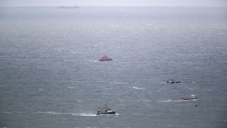 Boats continue their search for the missing two fishermen that went missing near Seaford, Sussex, after their fishing boat, Joanna C, sank off the coast near Seaford, East Sussex on Saturday.