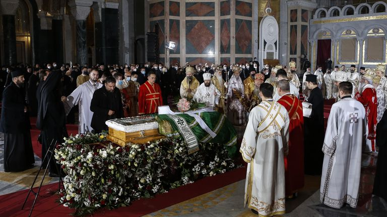Orthodox priests hold the church service during the funeral of the late Serbian Patriarch Irinej