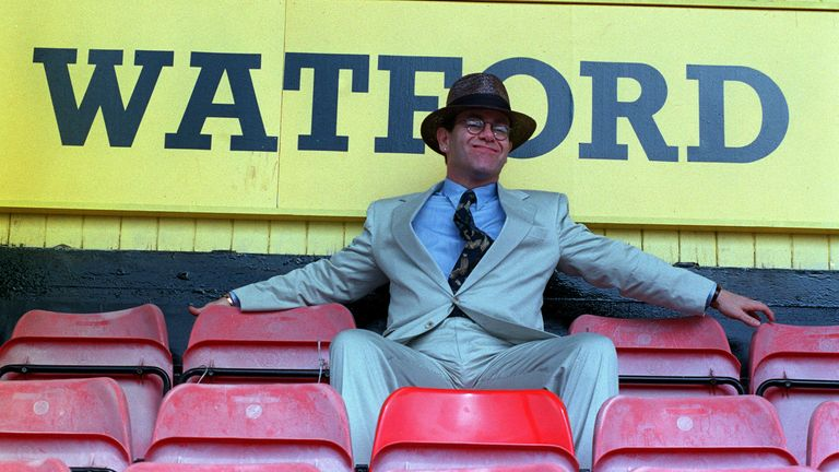 1991: Singer Elton John sits in the terraces at Watford FC's Vicarage Road ground where he announced that he had become a director of the club.
