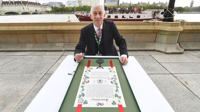 Sir Lindsay Hoyle with a scroll he presented to Nancy Pelosi. Pic: UK Parliament