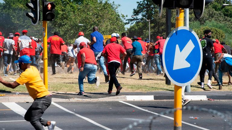 Opposition activists ran as police fired rubber bullets