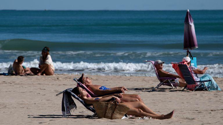People sunbathe near Valencia in Spain