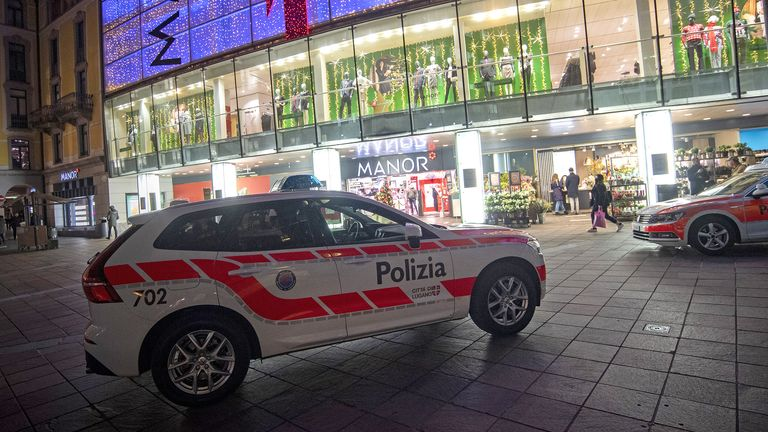 Police in front of the Manor department store in Piazza Dante in Lugano, Switzerland. Pic: Pablo Gianinazzi/EPA-EFE/Shutterstock