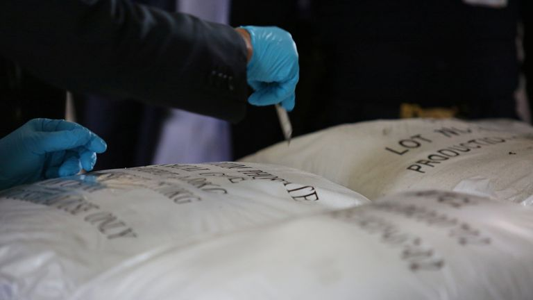 Officials view the seized 11.5 tonnes of ketamine, in the country's largest seizure ever, worth nearly 30 billion baht (~$991 million USD) at a warehouse in Chachoengsao, Thailand, November 12, 2020. Office of the Narcotics Control Board/Handout