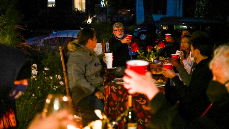 People hold socially distanced Thanksgiving celebrations