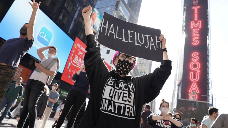 People celebrating Mr Biden's victory in Times Square, New York