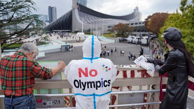 Anti-Olympics protesters outside the test event at the Yoyogi National Gymnasium in Tokyo, Japan