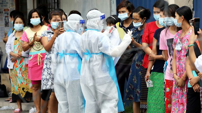 Top Glove workers in Klang wait to be tested for coronavirus