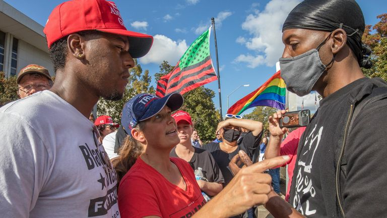 """Trump supporters (L) and Black Lives Matter supporters debate in front of the North Carolina Capitol in Raleigh, North Carolina, during a """"Protect The Results"""" rally. November 7, 2020. - Democrat Joe Biden has won the White House, US media said November 7, defeating Donald Trump and ending a presidency that convulsed American politics, shocked the world and left the United States more divided than at any time in decades. (Photo by Grant Baldwin / AFP) (Photo by GRANT BALDWIN/AFP via Getty Images"""