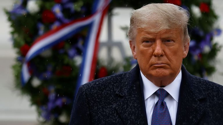 U.S. President Donald Trump turns after placing a wreath at the Tomb of the Unknown Solider as he attends a Veterans Day observance in the rain at Arlington National Cemetery in Arlington, Virginia, U.S., November 11, 2020. REUTERS/Carlos Barria