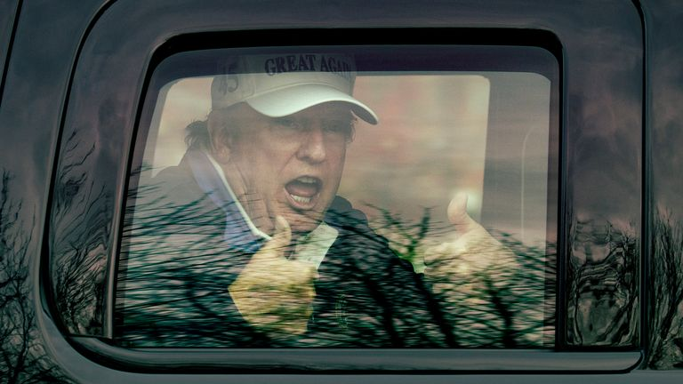 "U.S. President Donald Trump gives thumbs up to supporters from this motorcade after he golfed at Trump National Golf Club on November 22, 2020 in Sterling, Virginia. The previous day President Donald Trump left the G20 summit virtual event ""Pandemic Preparedness"" to visit one of his golf clubs as the virus has now killed more than 250,000 Americans"