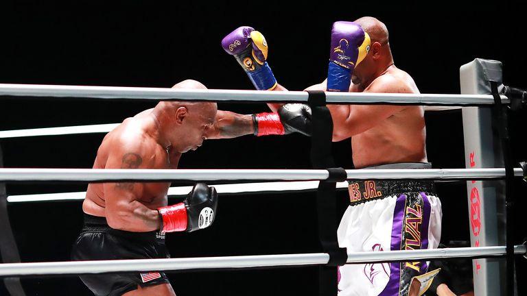 Mike Tyson (black trunks) fights Roy Jones, Jr.