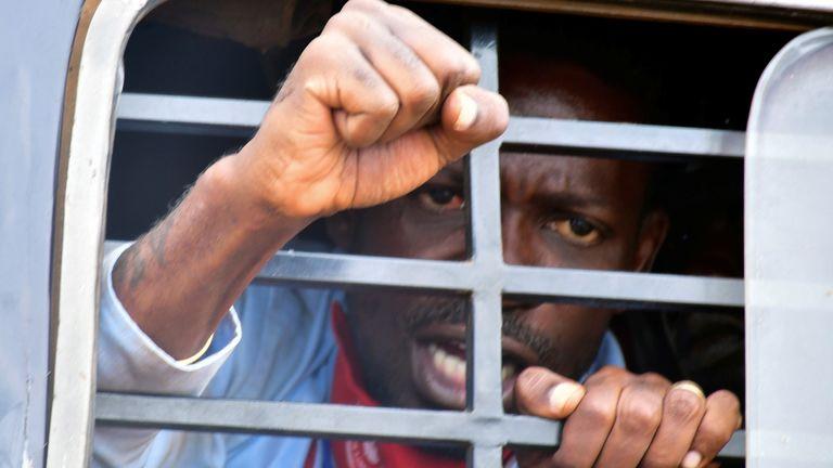 Ugandan presidential candidate Robert Kyagulanyi, also known as Bobi Wine, was taken away by police