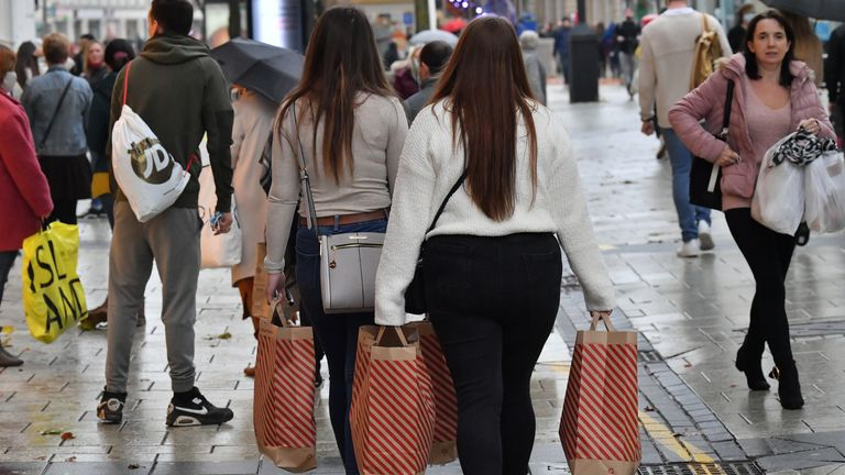 """People with Primark shopping bags in Cardiff, as restrictions are relaxed following a two-week """"firebreak"""" lockdown across Wales."""