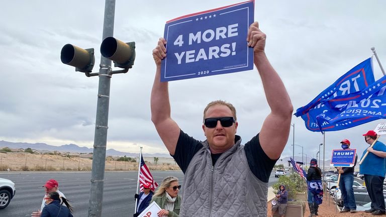 A Trump supporter stands in a Pro Trump gathering in Las Vegas following the US 2020 Presidential Election