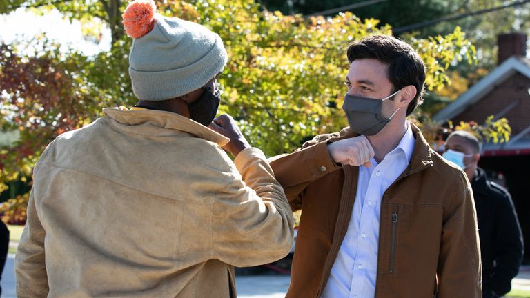 ATLANTA, GA - NOVEMBER 03: Democratic U.S. Senate candidate Jon Ossoff greets a supporter outside the Metropolitan Library polling location on November 3, 2020 in Atlanta, Georgia. Democratic Senate candidate Jon Ossoff is running against incumbent Se. David Perdue (R-GA) and Libertarian candidate Shane Hazel. Georgia is the only state with two Senate seats on the November 3 ballot. (Photo by Jessica McGowan/Getty Images)
