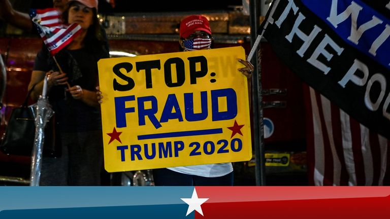 Trump supporters hold signs and flags during a protest in Miami, Florida on November 5, 2020. - Democratic presidential challenger Joe Biden on Thursday edged toward the magic number of 270 electoral votes needed to win the White House, but several battleground states were still in play, as incumbent President Donald Trump cried foul over the ongoing vote count. (Photo by CHANDAN KHANNA / AFP) (Photo by CHANDAN KHANNA/AFP via Getty Images)