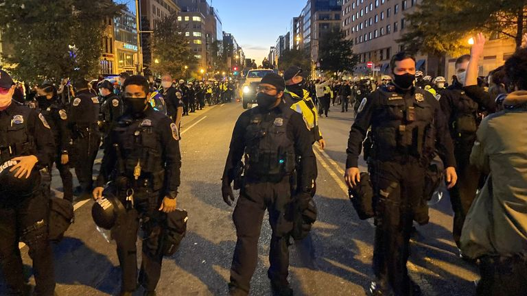 Police in Washington DC escort a truck of musical performers