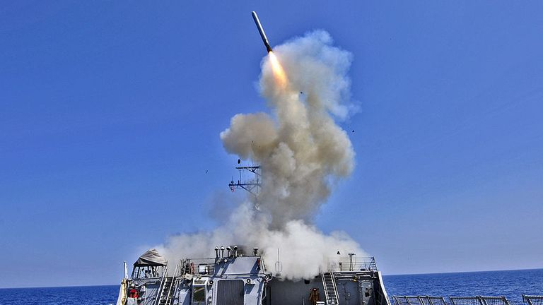 The guided missile destroyer USS Barry (DDG 52) launches a Tomahawk cruise missile March 29, 2011, from the Mediterranean Sea in support of Operation Odyssey Dawn. A coalition of nations have partnered to enforce United Nations Security Council Resolution 1973, which authorizes all necessary measures to protect Libyan civilians under threat of attack by Libyan leader Col. Moammar Gadhafi